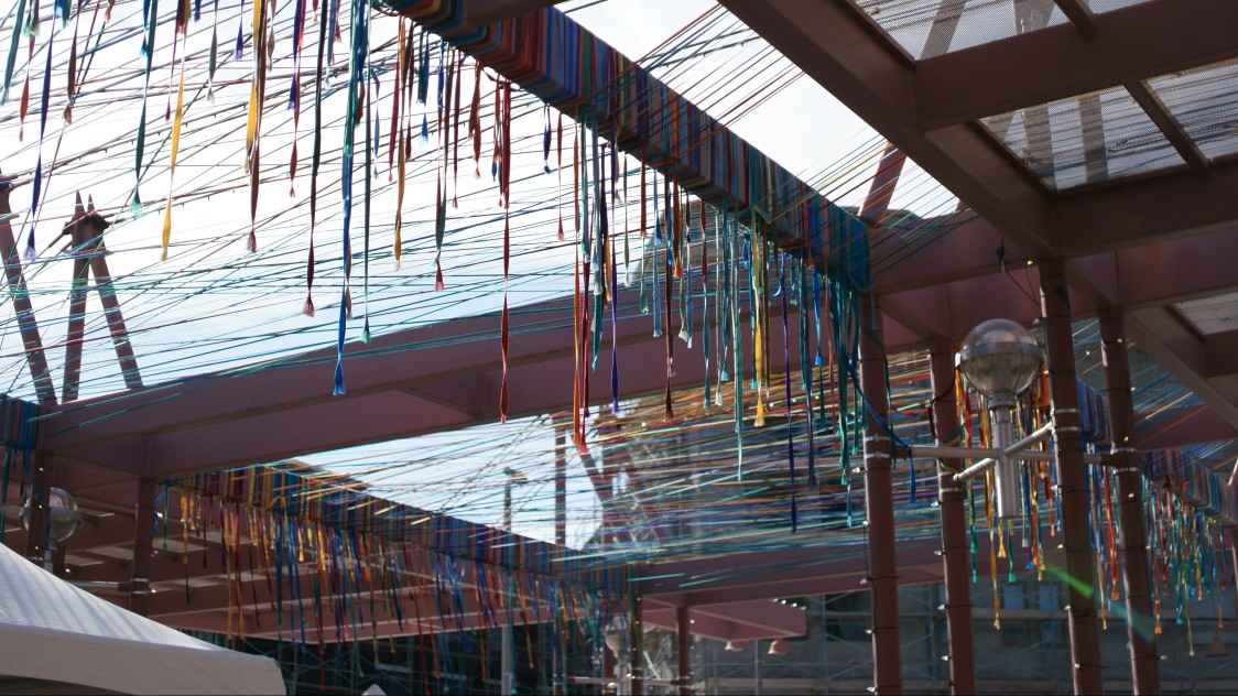 Randy Walker transforms the Marshall Way Bridge with thousands of colorful fabric strands.